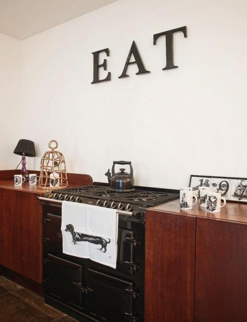brązowo czarna, męska kuchnia  zdjęcie w serwisie
